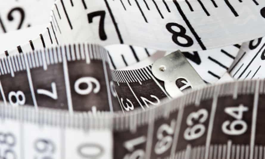 Measuring tape, symbol of tailoring and diets.