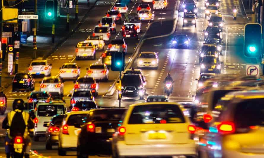 queue of cars in traffic jam at night