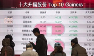 A board displaying the top gainers on the Hang Seng Index in Hong Kong. A global 2018 stock market rally showed signs of losing momentum New York and London stocks stalled, but Asia and eurozone markets managed to power on.