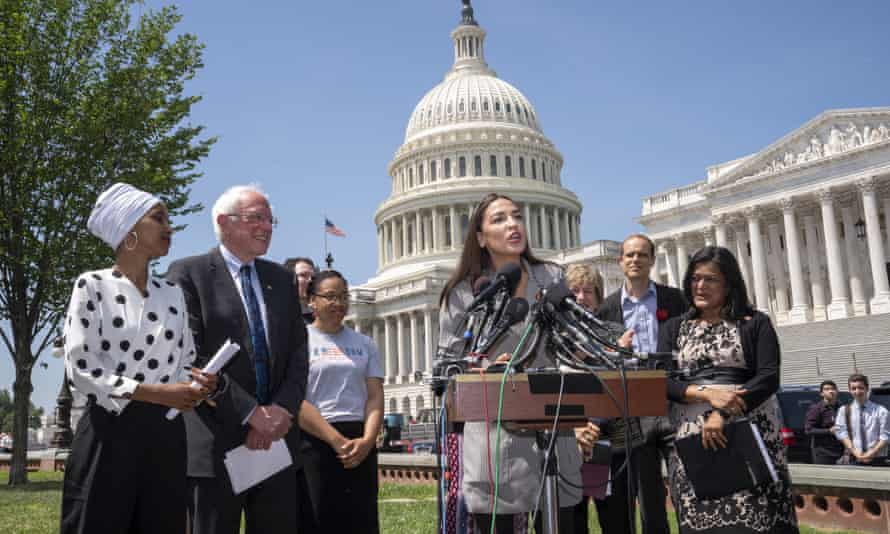 The Democratic lawmakers Ilhan Omar, Bernie Sanders, and Pramila Jayapal listen as Alexandria Ocasio-Cortez joins them in a call for legislation to cancel all student debt.