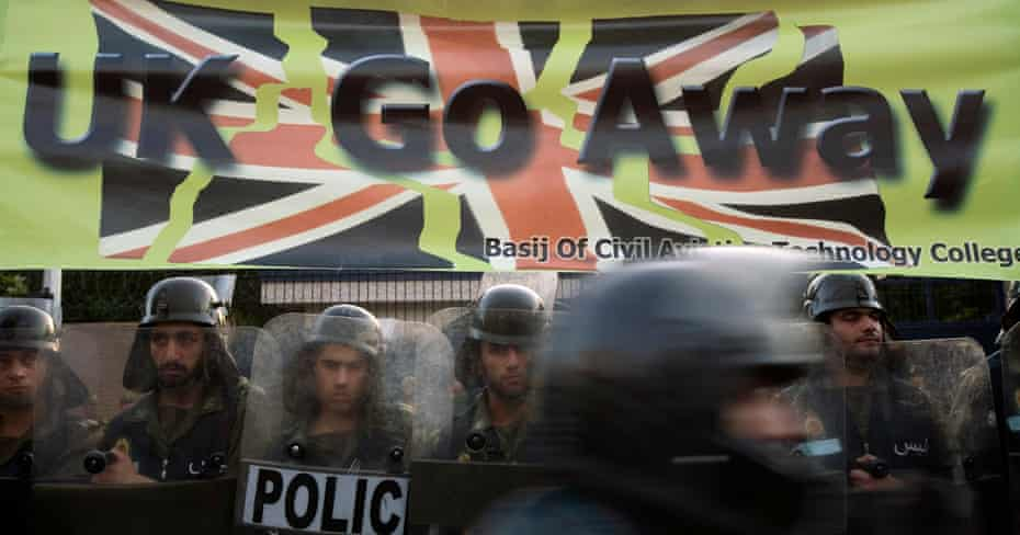 Police guard the British embassy in Tehran during a demonstration by hardline students