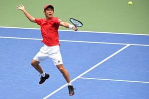 Yoshihito Nishioka hits a backhand volley .