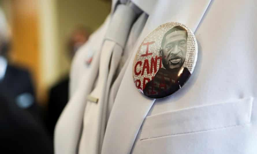 A mourner wears a button saying 'I can't breathe' before the funeral for George Floyd on Tuesday.