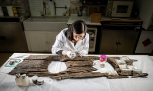 Conservator Luisa Duarte working on the 12th-century toilet seat
