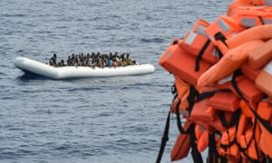 People waiting to be rescued on a boat in the Mediterranean earlier this month.
