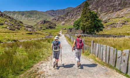 Two hikers ascending the Watkin Path towards the summit of Snowdon in Wales