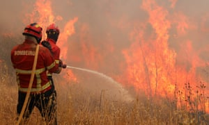 A forest fire ravages the Rasmalho area of Monchique, Algarve, southern Portugal, on Tuesday