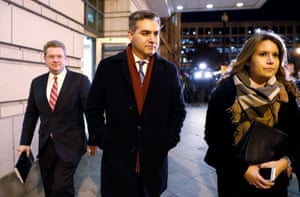 Jim Acosta (center) leaves a hearing on CNN's lawsuit.