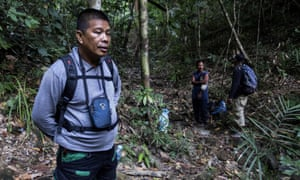 Ruben Arzaga (L), who was shot dead by illegal loggers