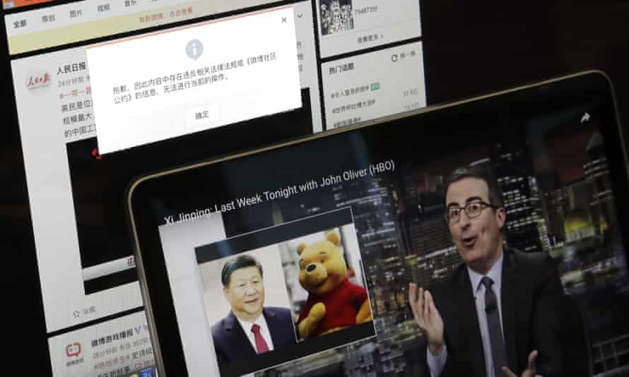 A screen shows a failure message saying a post could not be sent because 'the content contains information that violates relevant laws and regulations' on Sina Weibo next to a smaller computer screen showing a Last Week Tonight host John Oliver with a photo of Chinese President Xi Jinping and Winnie the Pooh.