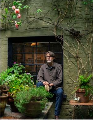 Nigel Slater framed by beloved ferns and climbing roses.