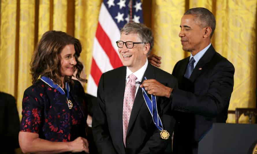 Bill and Melinda Gates receive medals from Obama at presidential medal of freedom ceremony in November 2016.
