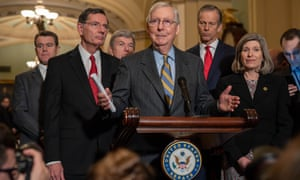 US senate majority leader Mitch McConnell, a Republican, joined by fellow Republican leaders talk to the press after it was announced earlier that the House Democrats plan to vote Wednesday to send two articles of impeachment against President Donald Trump to the Senate