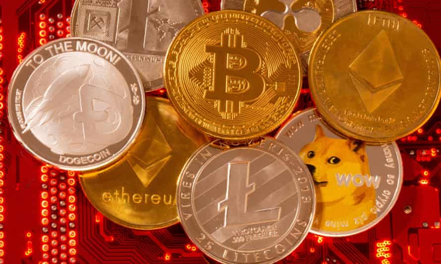Representations of cryptocurrencies Bitcoin, Ethereum, DogeCoin, Ripple, Litecoin are placed on PC motherboard