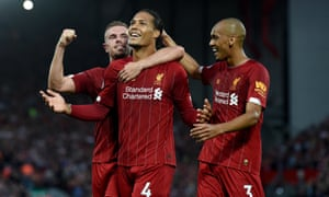 Virgil Van Dijk is congratulated his teammates after scoring Liverpool's third goal.