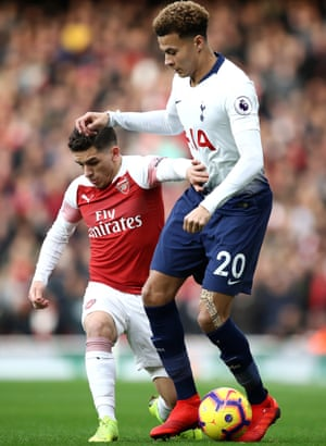 Lucas Torreira battles for possession with Dele Alli