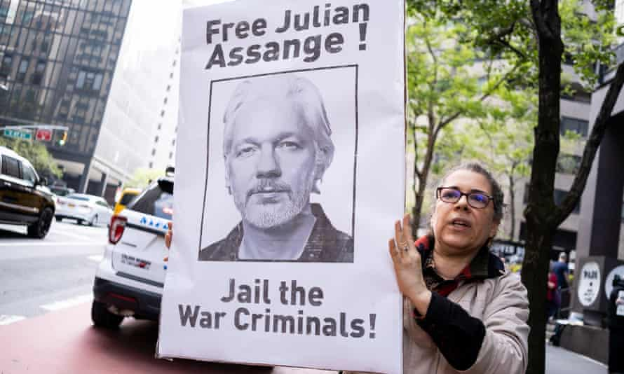 A woman protests in New York against Julian Assange's prison detention in the UK.