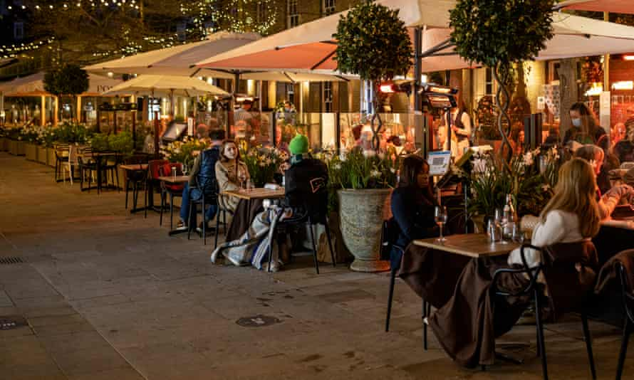 Diners eating outdoors at a restaurant near the King's Road on April 20, 2021 in London.