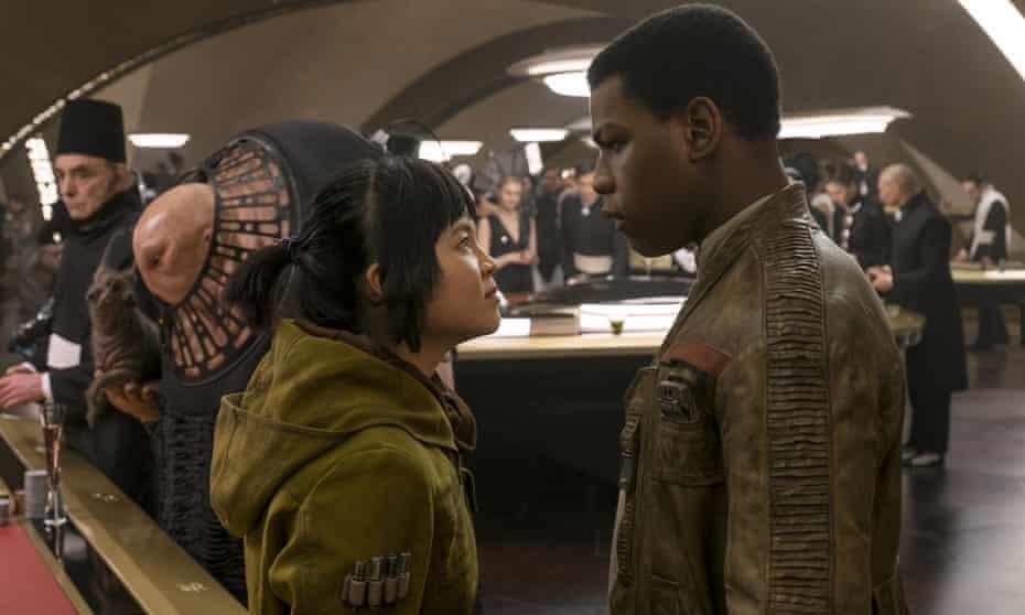 John Boyega with Kelly Marie Tran in Star Wars: The Last Jedi