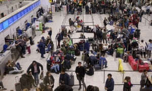 People wait in the departures area at Gatwick airport as the airport remains closed after drones were spotted over the airfield since last night.