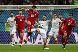 Spain's Sergio Busquets in action with Iran's Sardar.