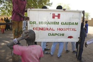 People gather outside the hospital where the freed girls are being treated, in Dapchi.
