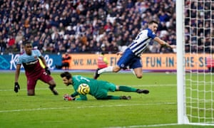 Brighton and Hove Albion's Pascal Gross slots the ball past West Ham United goalkeeper Lukasz Fabianski and into the net to put the visitors back in the game.