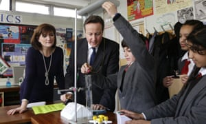 Nicky Morgan and David Cameron observe school science experiment