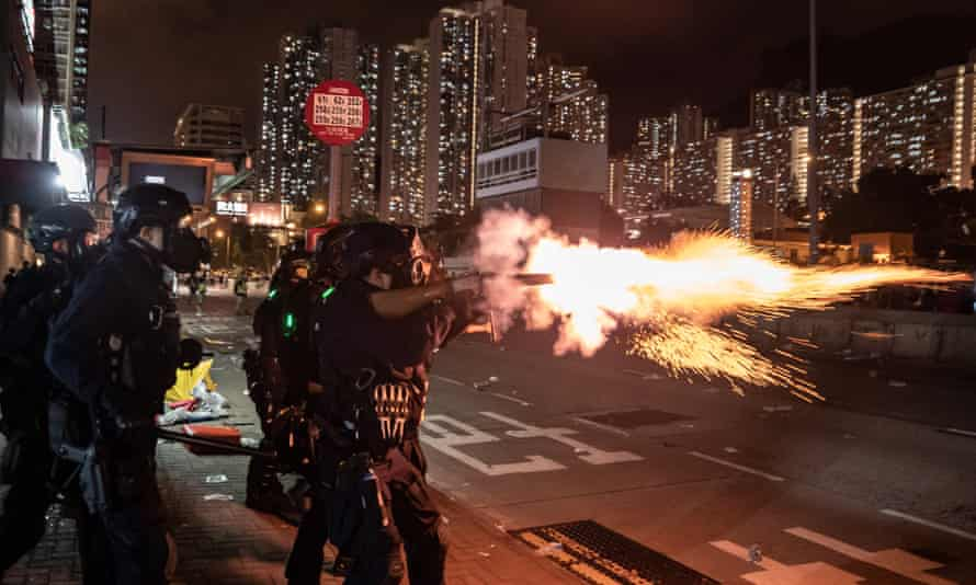 Riot police fire teargas at protesters in Hong Kong