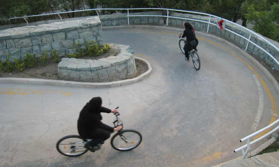 Iranian women ride their bikes at Tehran's 'Mothers' Paradise' park, the Iranian capital's women-only public recreation area.