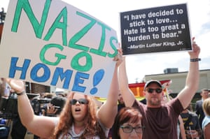 Protesters try to drown out a news conference held by 'alt-right' blogger Jason Kessler in Charlottesville, Virginia