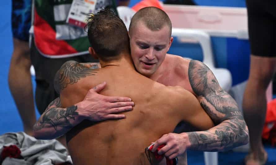 Adam Peaty (right) hugs Caeleb Dressel after a thrilling 4x100m medley final