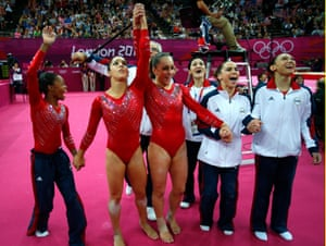 Kyla Ross (right) celebrates with teammates (left to right) Gabrielle Douglas , Alexandra Raisman, Jordyn Wieber, and McKayla Maroney after winning gold in the women's gymnastics team final at London 2012.