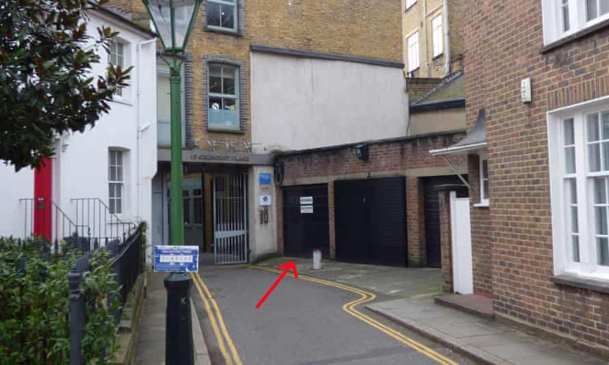 A single garage (with 'no parking' sign) in Chelsea's Crescent Place has sold for double the guide price.