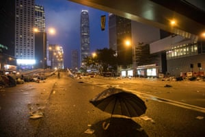 Debris left on a road after protesters were cleared from the area by police after a day of demonstrating about government plans to allow extraditions to mainland China