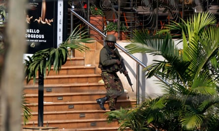 A Kenyan soldier walks out of the main gate of Westgate shopping centre in Nairobi, 2013