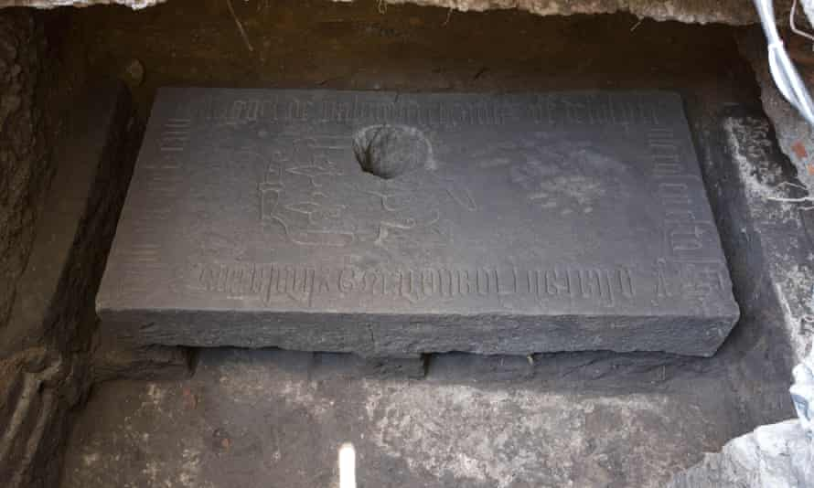 A stone slab lies near the cathedral in Mexico City on Wednesday after being discovered by accident by workers digging foundations for a lamp-post.