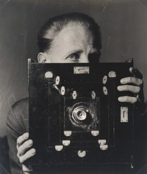 Portrait of Bill Brandt (1904 - 1983) with his Kodak Wideview Camera, 1945