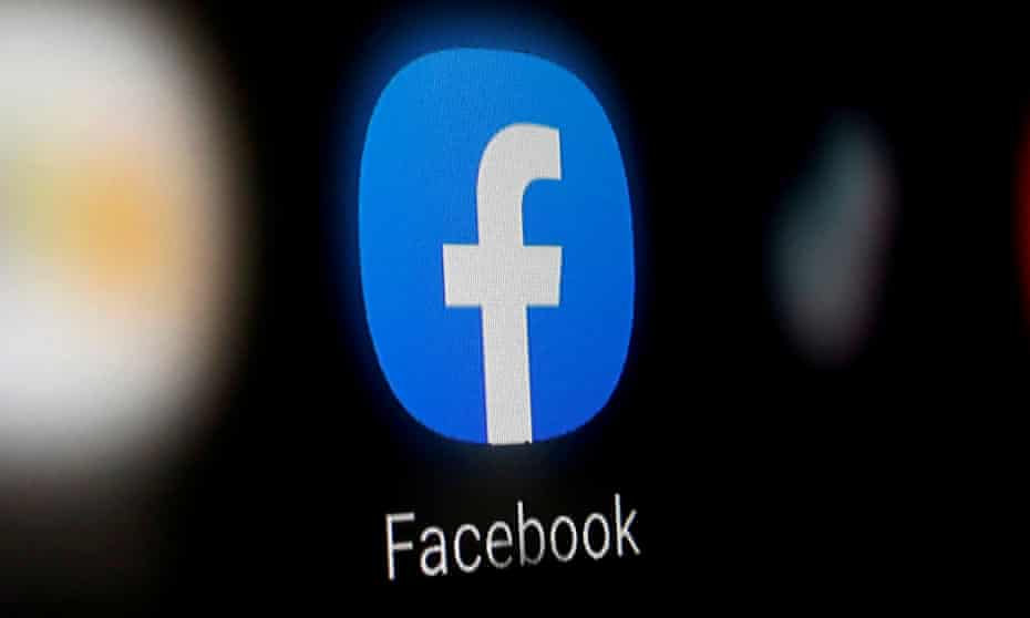A Facebook logo is displayed on a smartphone
