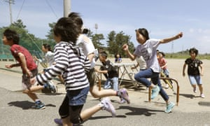 Children in Sakata, Japan, take part in an evacuation drill earlier this year.