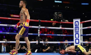 Vasiliy Lomachenko walks away after putting the prone Anthony Crolla out for the count at the the Staples Center.