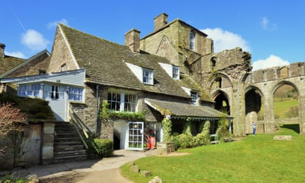 Exterior of Llanthony Priory Hotel, with ruins,