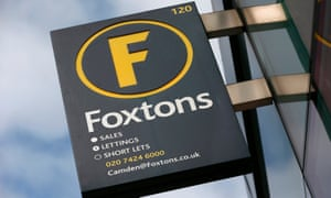 Foxtons estate agent sign outside a branch in north London