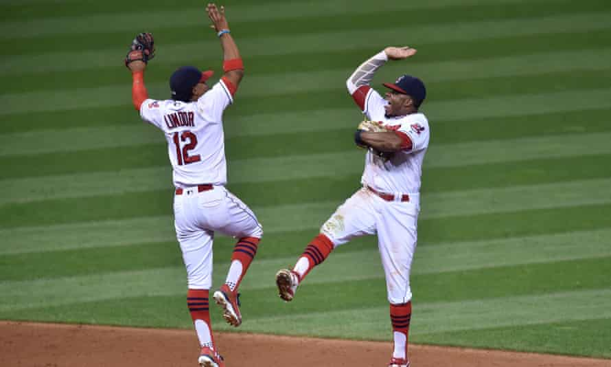 Francisco Lindor (12) and Rajai Davis (20) celebrate a 5-4 win over the Minnesota Twins. The Indians are well ahead in the AL Central, and have the postseason in sight.