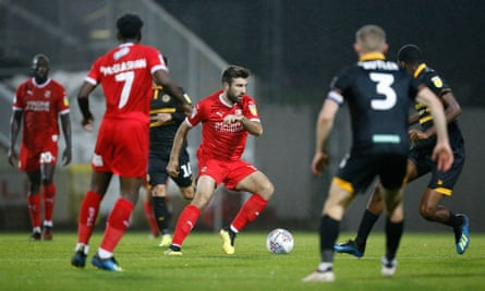 Michael Doughty in action for Swindon against Newport.