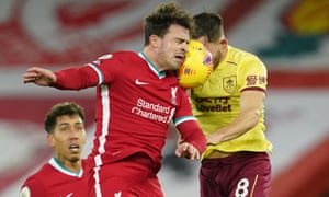 Liverpool's Xherdan Shaqiri (left) goes up for a header with Burnley's Josh Brownhill.