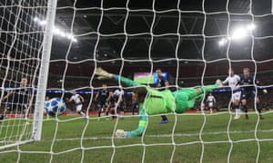 PSV Eindhoven's goalkeeper, Jeroen Zoet, dives to his left but is unable to stop a deflected Harry Kane header from trickling in at the near post.