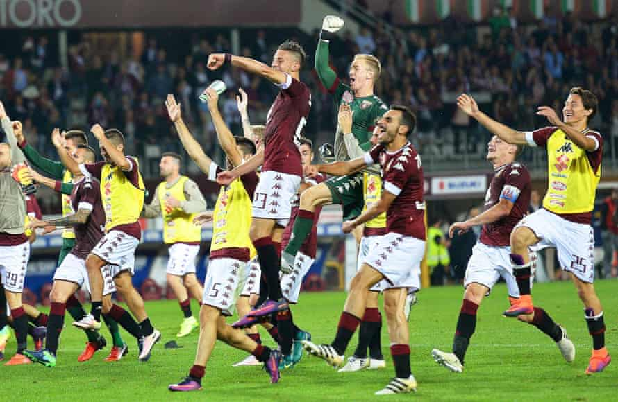 Joe Hart joins his Torino team-mates in celebration after the win over Fiorentina