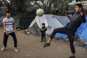 Children play outside Moria