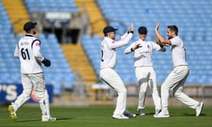 Warwickshire's Chris Woakes (right) celebrates the wicket of Yorkshire's Gary Ballance during a match-winning performance from the England bowler.